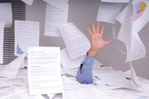 Business-man-buried-under-paper1